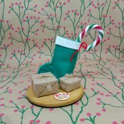 Bota navideña guarda-dinero...